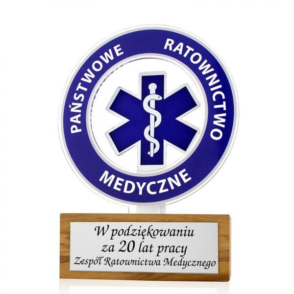 Statuetka z elementami pleksi na drewnianym postumencie na podziękowanie dla pracownika ratownictwa medycznego