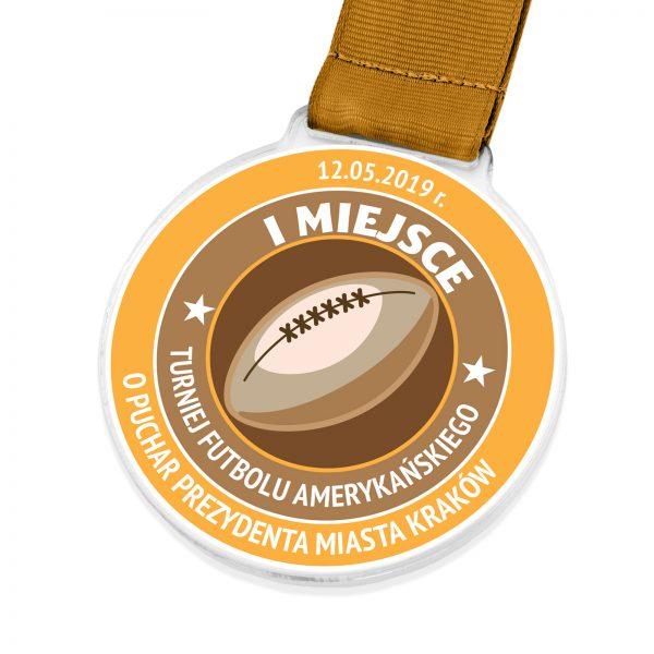 Medal z przeźroczystej pleksi na turniej futbolu amerykańskiego