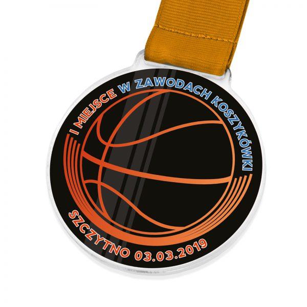 Medal z przeźroczystej pleksi za zajęcie I miejsca w zawodach koszykówki