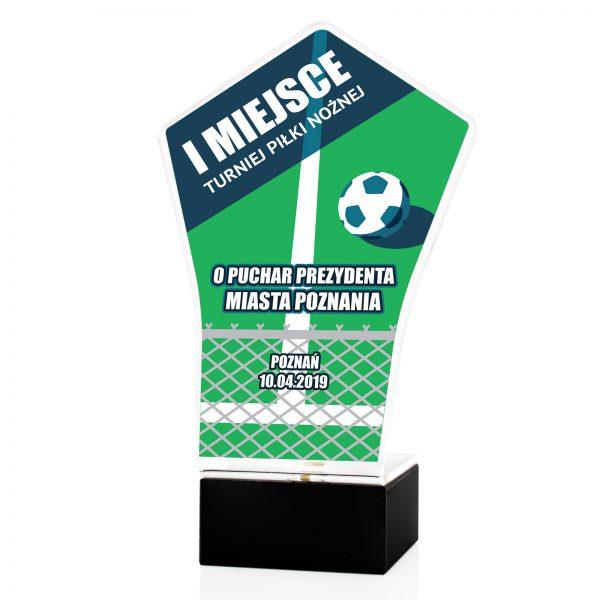 Statuetka z pleksi na postumencie na turniej Piłki Nożnej
